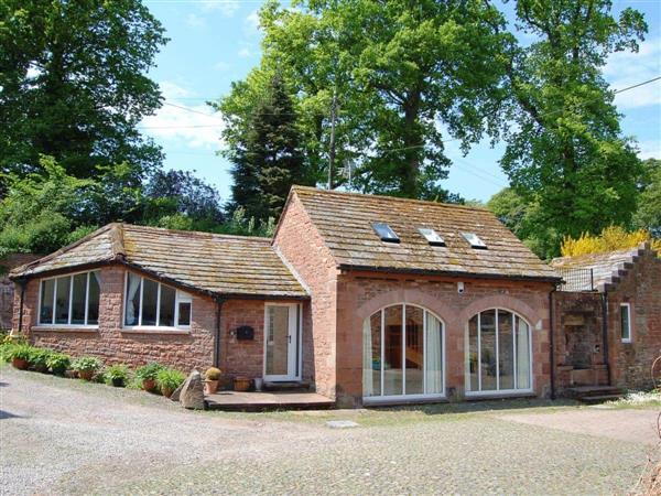 Woodstore Cottage** in Cumbria